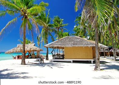 pictorial tropical scene with native bungalows