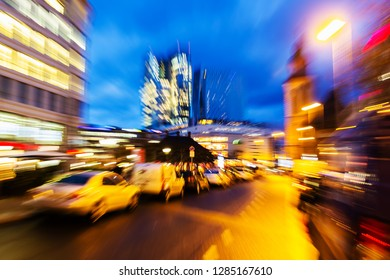 picture with abstract camera made zoom effect of a street scene in the city at night