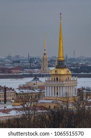 A picture of the Admiralty Building's pointy tower on the foreground, with the Neva river and Peter and Paul Fortress in the back.