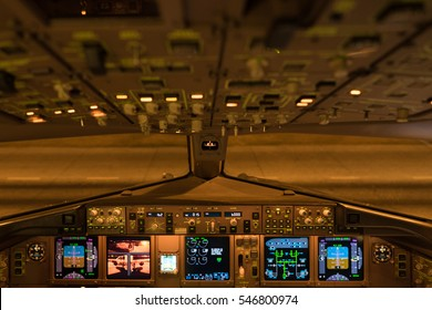 Picture of airplane cockpit taken in night time