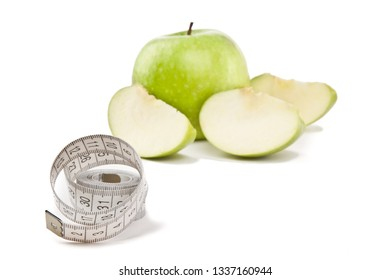 Picture of apples and tape measure on the white background. Concept of diet. (focus on tape measure)