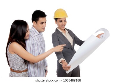 Picture of Asian female architect showing a blueprint to her client, isolated on white background