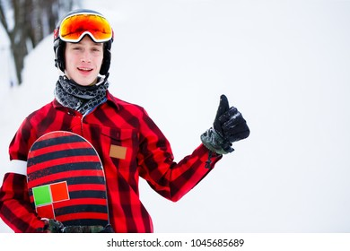 Picture of athlete in helmet with snowboard on blurred background