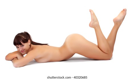 Picture of attractive sporty girl lying on white background, studio shot