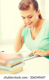 picture of attractive student girl using tablet pc