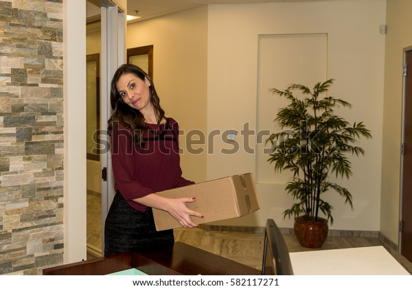 Picture of attractive young business woman delivering a box
