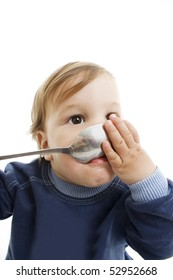 Picture of baby boy with big spoon over white