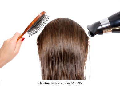 Picture of the back of a woman with long hair over white background trying to dry hair