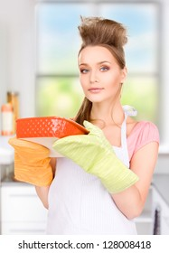 picture of beautiful cooking housewife in the kitchen