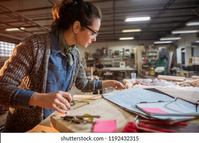 Picture of beautiful focused middle aged woman architect in her workshop working on new projects.