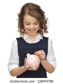 picture of beautiful girl with piggy bank