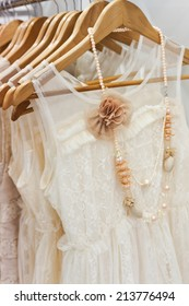 A picture of beautiful lace white dress on the hanger.
