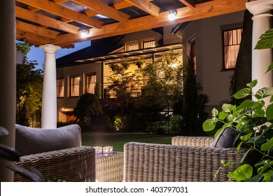 Picture of beautiful residence with garden at night