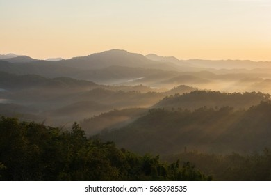 A picture of beautiful sky and foggy of layer mountain gold sunrise, Thailand.