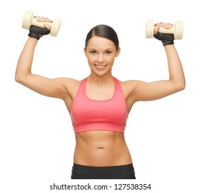 picture of beautiful sporty woman with dumbbells