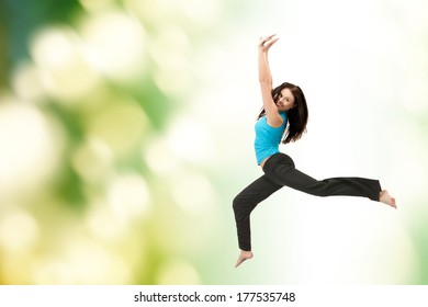 picture of beautiful sporty woman jumping in sportswear