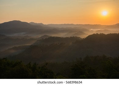 A picture of beautiful view in Thailand, sky and foggy of layer mountain with sunrise.