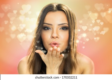 Picture of beautiful woman blowing hearts, cute female send romantic kiss, Cupid girl, Valentines day, sweet holiday, romance and love concept