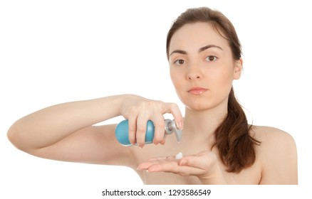 Picture of a beautiful woman with a blue bottle of a cream smiling isolated on white