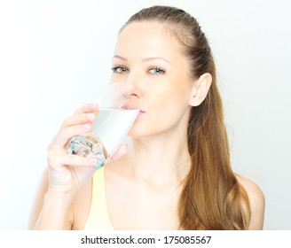 picture of beautiful woman with glass of water .