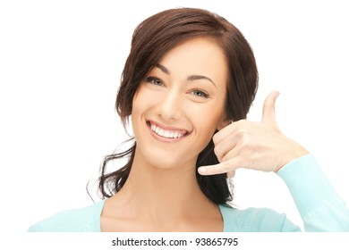 picture of beautiful woman making a call me gesture