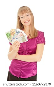 Picture of beautiful woman in pink shirt holding euro banknotes in her hands isolated on white