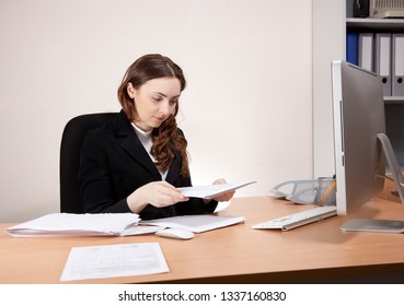 Picture of beautiful working,businesswoman with financial report at office