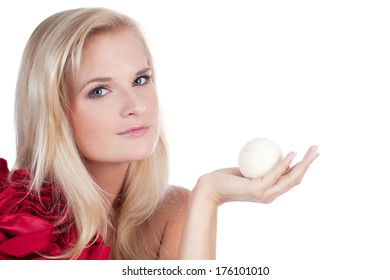 Picture of beautiful young woman with aroma ball for bathing in her hands