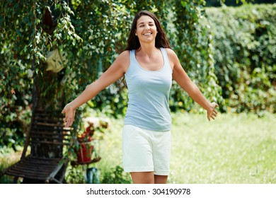 Picture of a beautiful young woman enjoying the summer