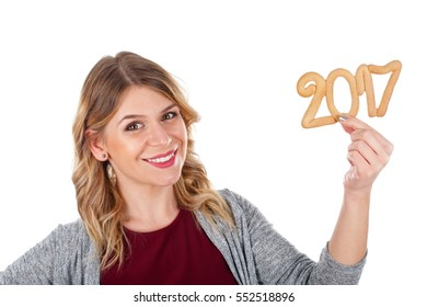 Picture of a beautiful young woman holding a 2017 gingerbread