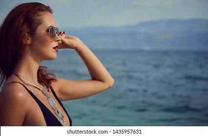 Picture of a beautiful young woman with swimsuit in vacation in Croatia,