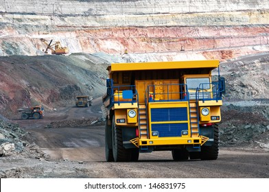 A picture of a big yellow mining trucks at work site
