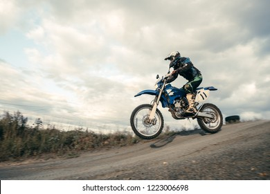 A picture of a biker making a stunt