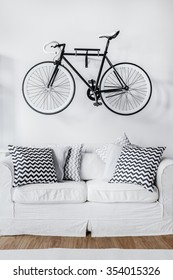 Picture of black and white bicycle and couch