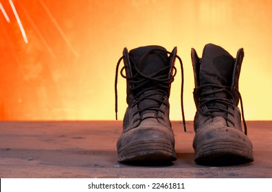 a picture of black work boots on a steel table
