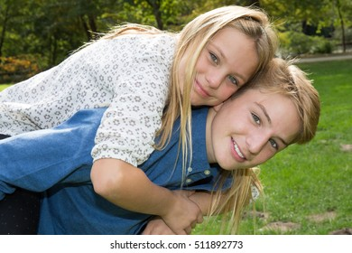Picture blond brother and sister outdoors