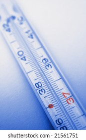 picture of blue colored thermometer, 37 degrees in red color