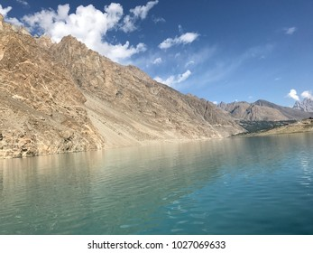 picture of blue water lake  with hill and  blue cloudy sky