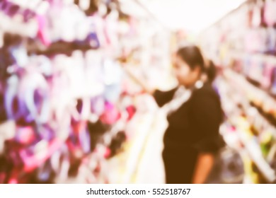 Picture blurred  for background abstract and can be illustration to article of Woman shopping at the supermarket