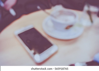 Picture blurred  for background abstract and can be illustration to article of Phone and coffee in cafe