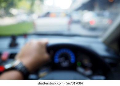 Picture blurred  for background abstract and can be illustration to article of hands driving car steering wheel