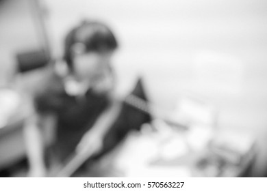 Picture blurred  for background abstract and can be illustration to article of businesswoman talking on telephone in office