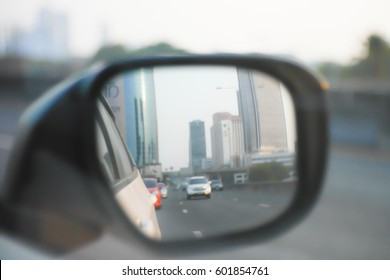 Picture blurred  for background abstract and can be illustration to article of side rear view mirror on a car