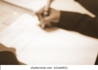 Picture blurred  for background abstract and can be illustration to article of people hand write