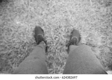 Picture blurred  for background abstract and can be illustration to article of people standing on grass