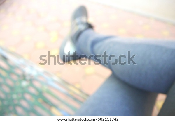 Picture blurred  for background abstract and can be illustration to article of sit with one's legs crossed