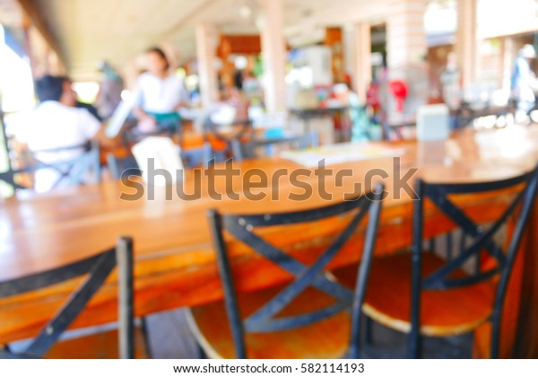 Picture blurred  for background abstract and can be illustration to article of table in restaurant