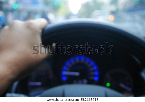 Picture blurred  for background abstract and can be illustration to article of hand drive wheel car