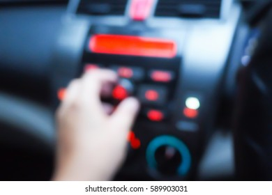 Picture blurred  for background abstract of Hand tuning fm radio button in car panel