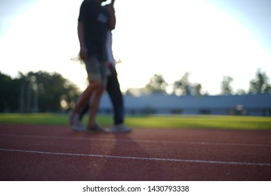 Picture blurred for background abstract ,Uniform people exercise morning at stadium in Chiang Rai Thailand.